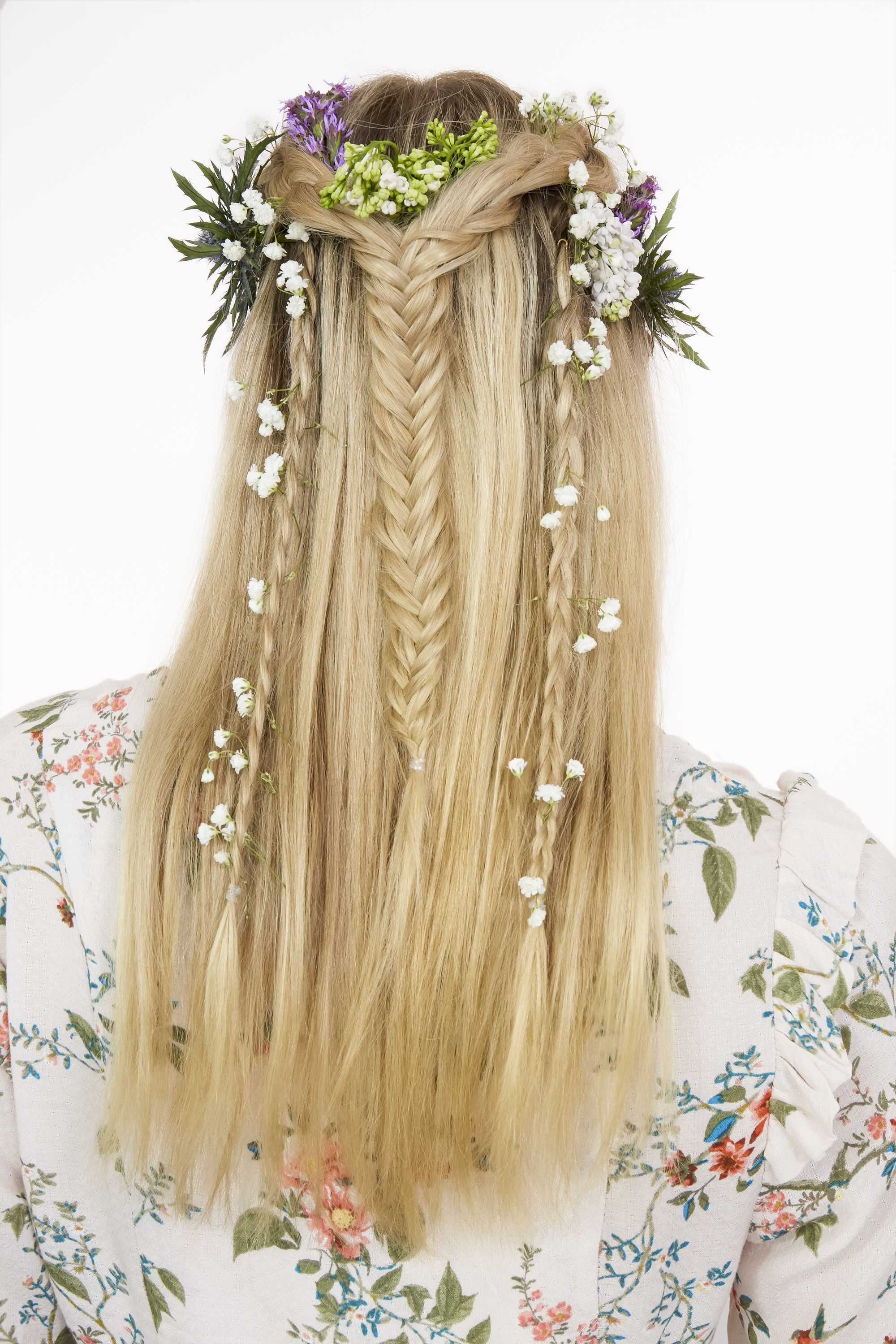 Woman with blonde straight hair in half-up braid