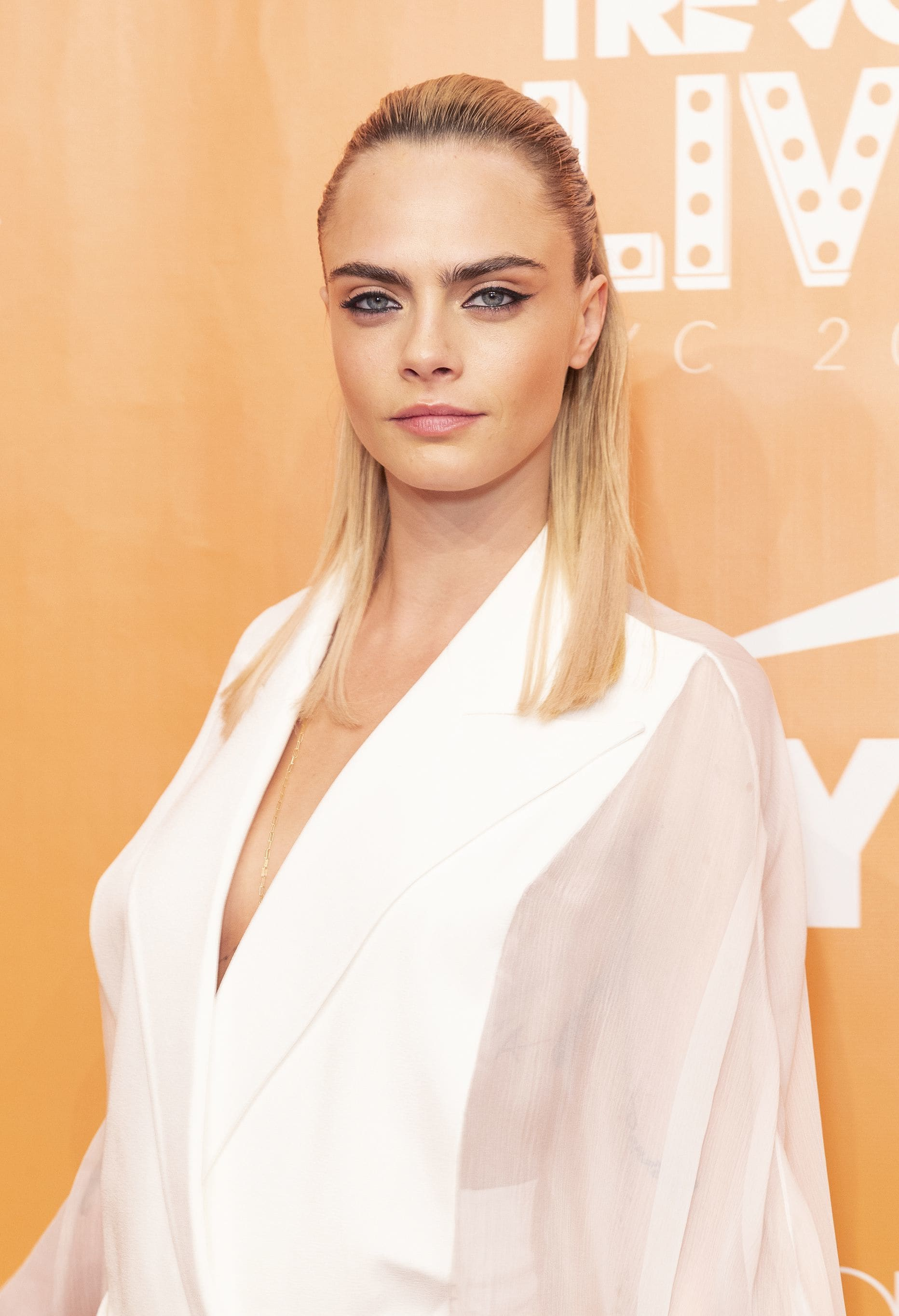 Cara Delevingne with straight blonde half-up, half-down
