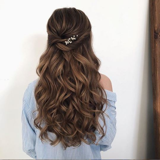 Long brown wavy half-up with flowers