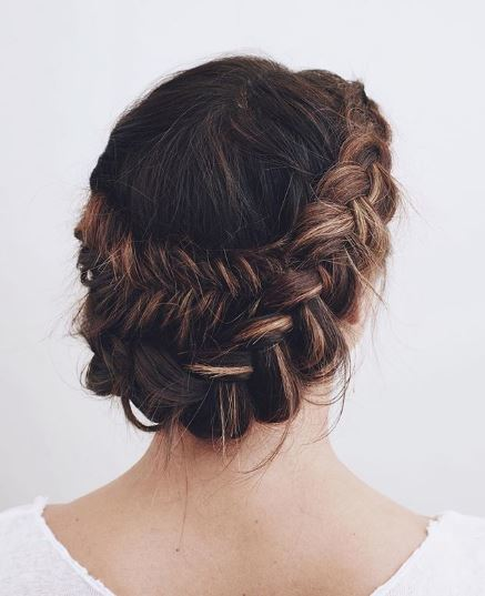 Brunette woman with fishtail halo braid