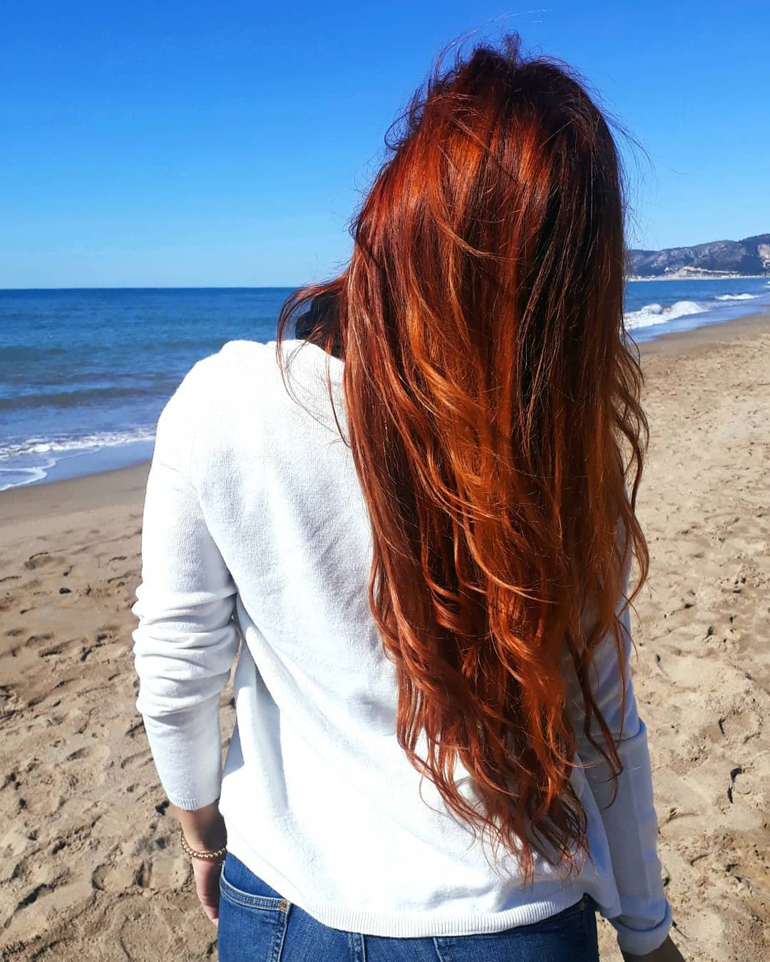woman with long henna dyed red hair
