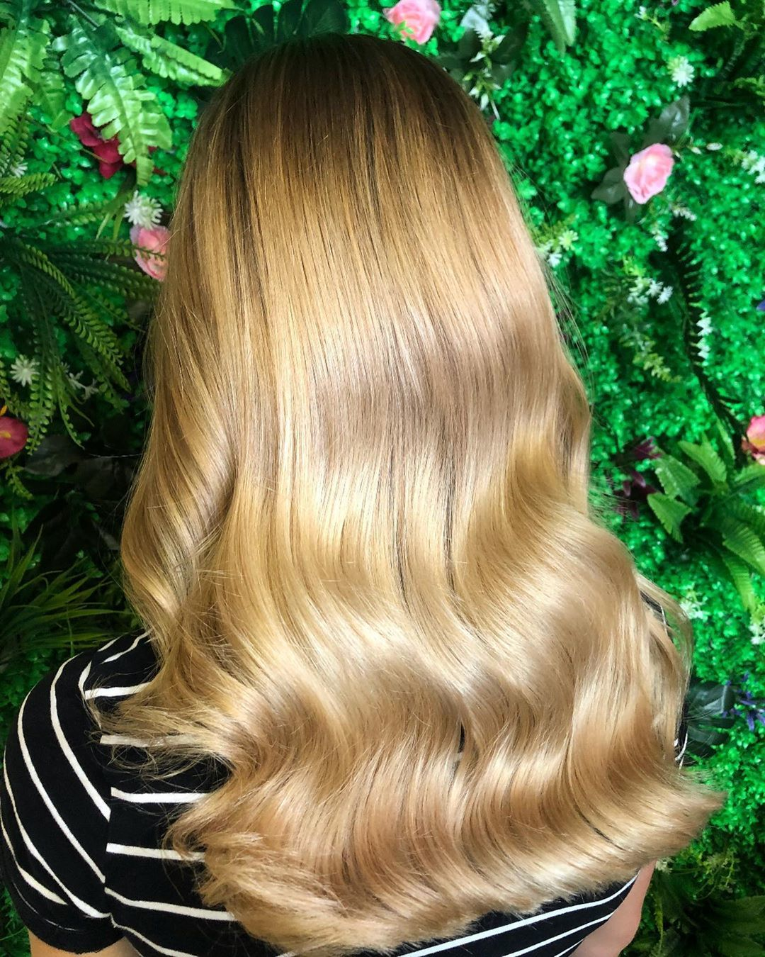 woman with long and wavy honey blonde hair