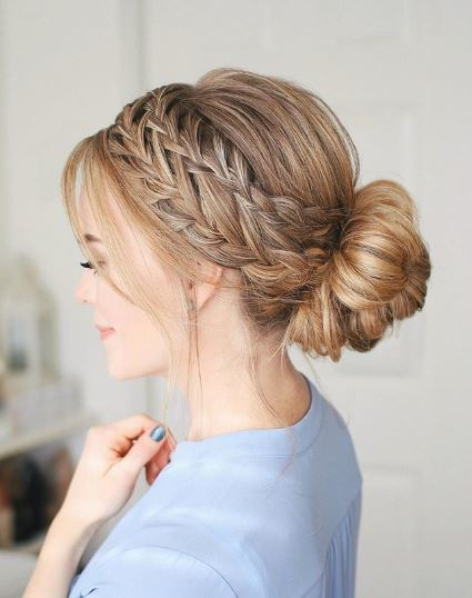 Blonde woman with hair in braided bun