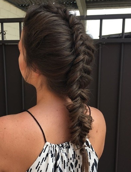 Brunette woman with a long inverted fishtail braid