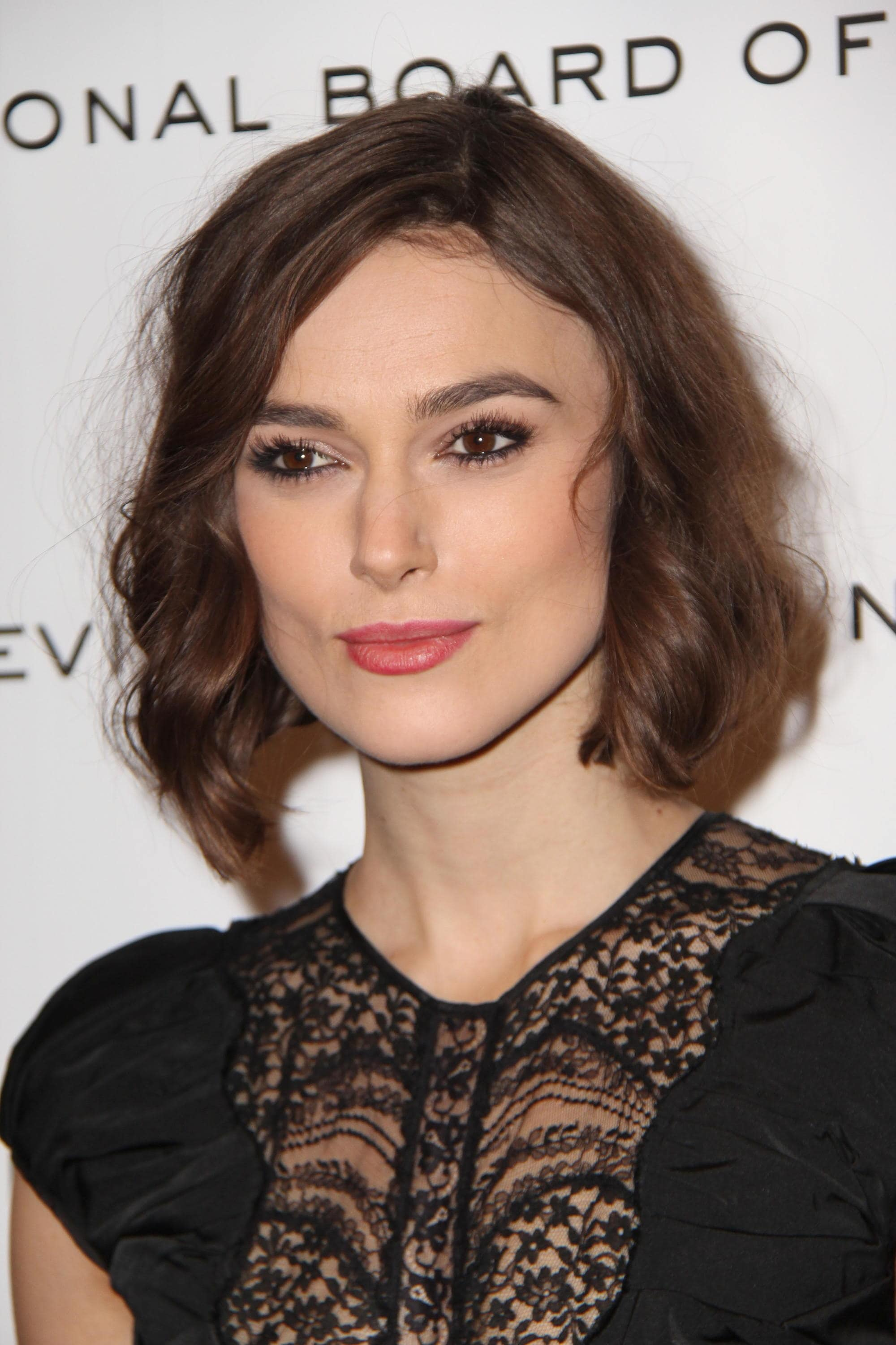 Keira Knightley with a brunette wavy bob