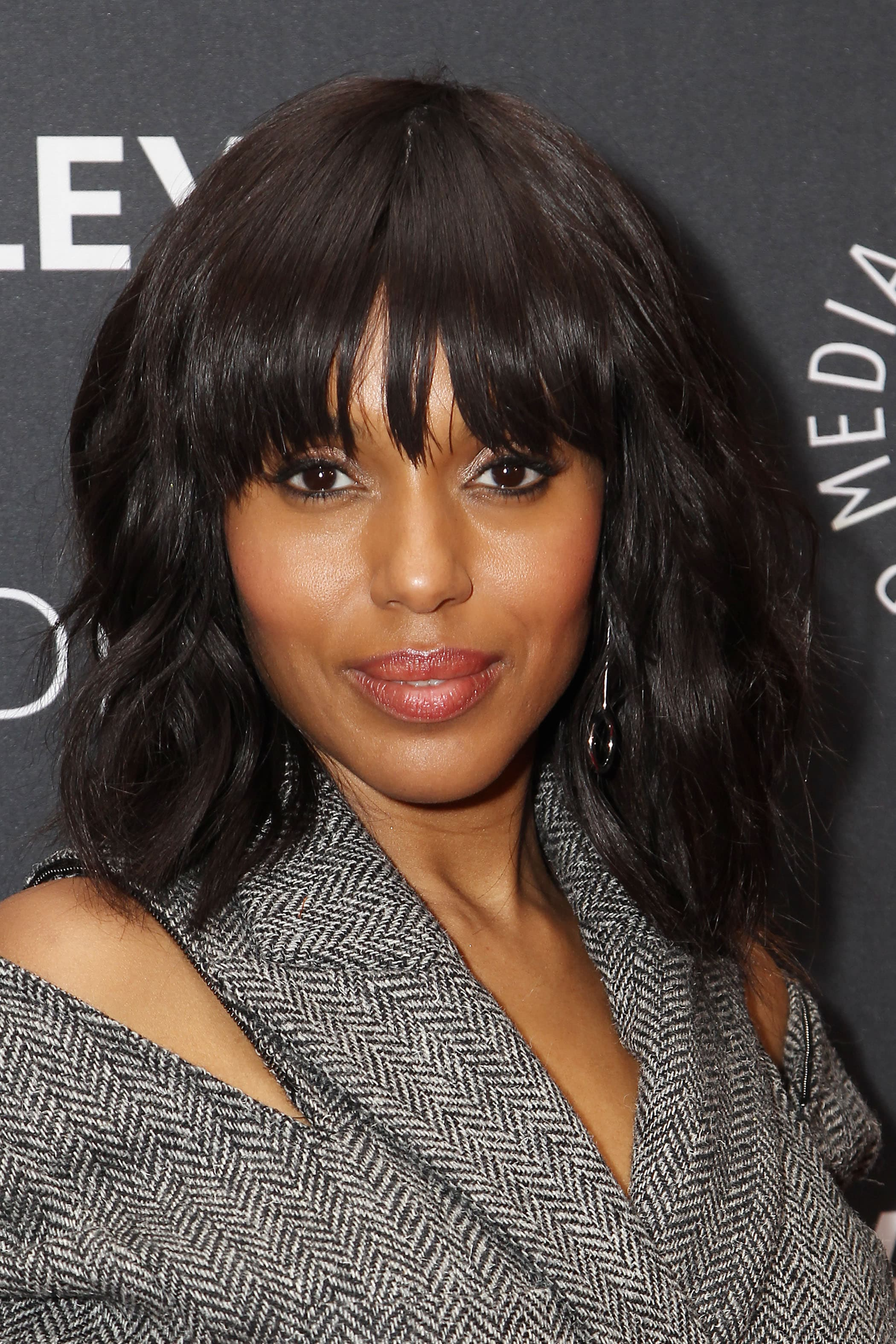 Kerry Washington with a black wavy bob with bangs
