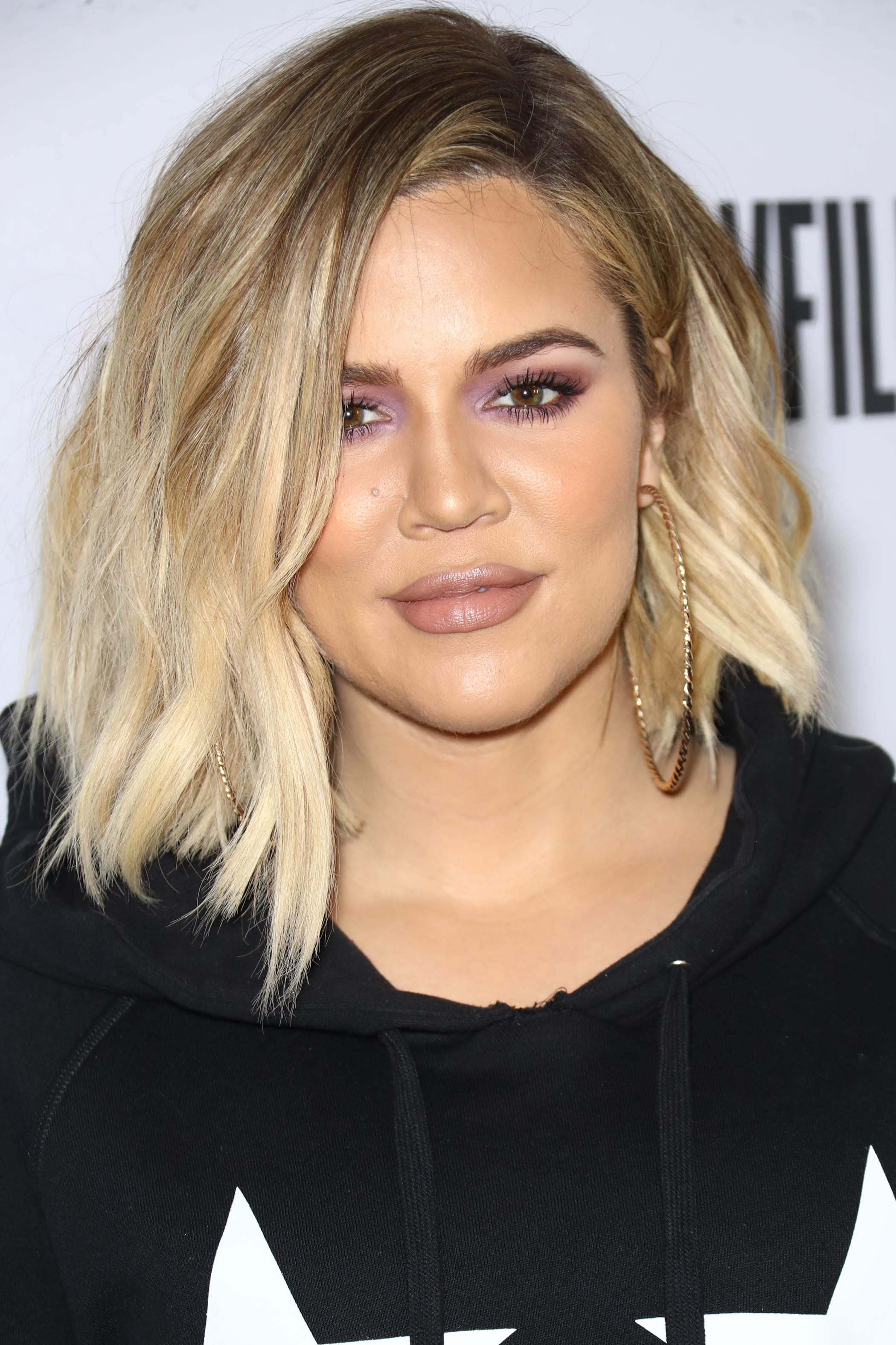 Khloe Kardashian with a blonde wavy lob