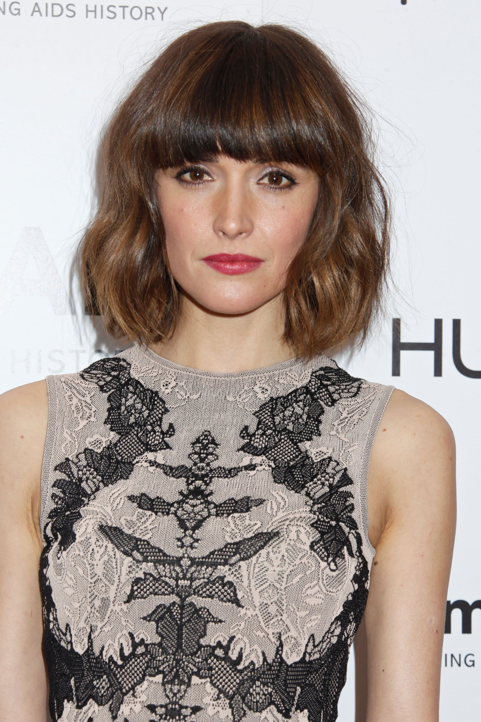 Rose Byrne with a brunette layered wavy bob with bangs