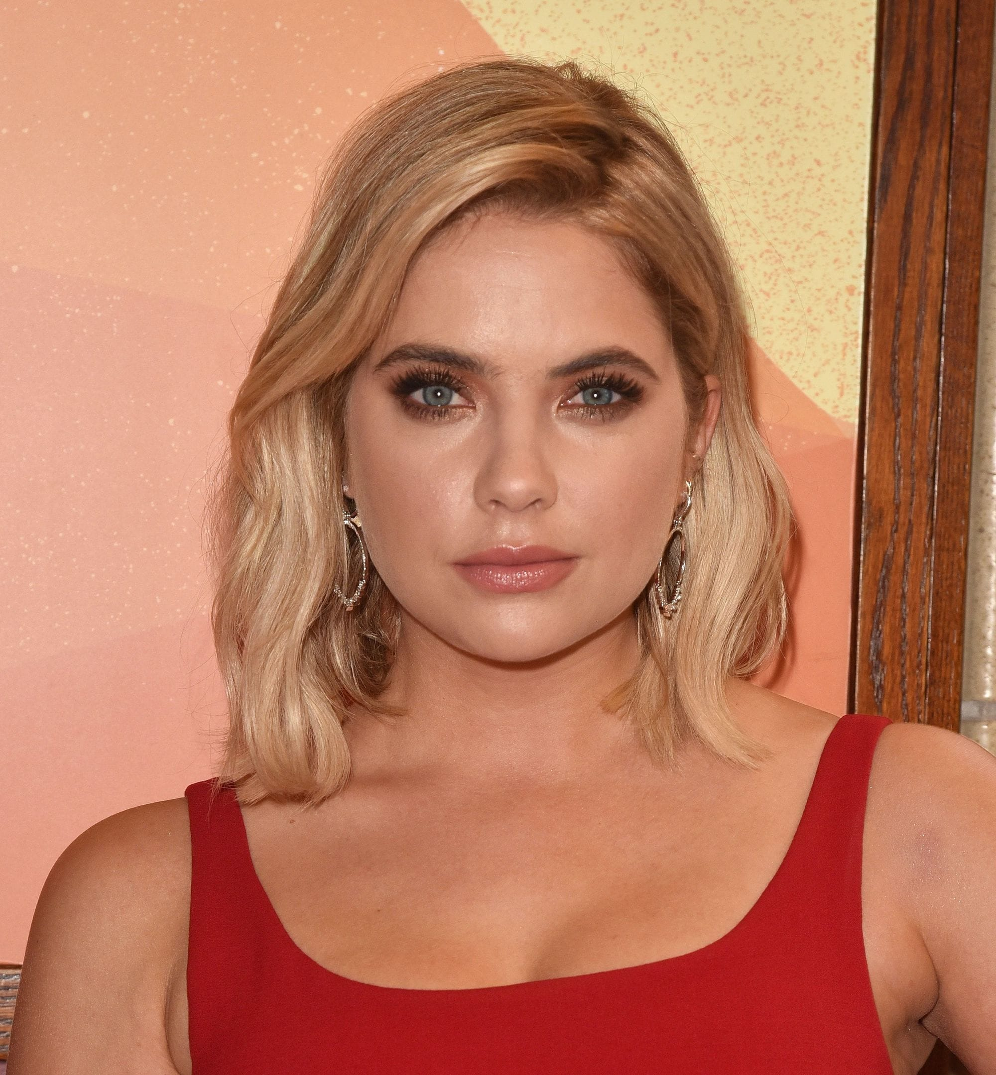 Ashley Benson with a honey blonde wavy lob