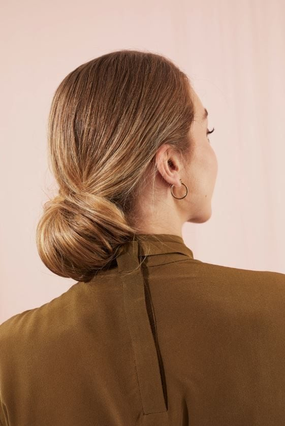 Woman with blonde hair in low chignon