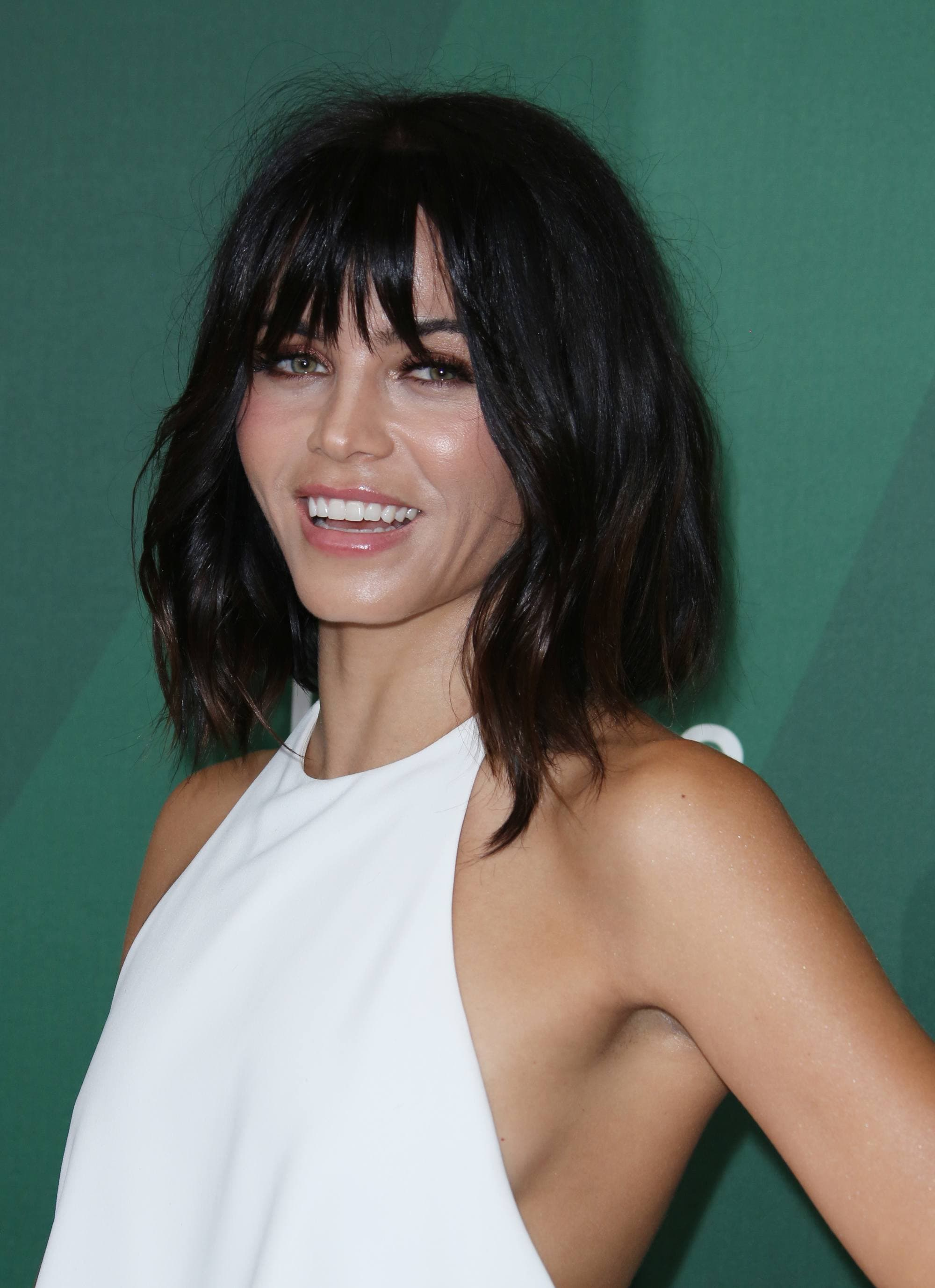 Jenna Dewan with a black mid length wavy bob with bangs