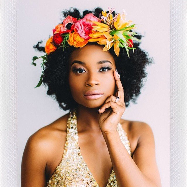 Woman with medium natural afro with flower crown