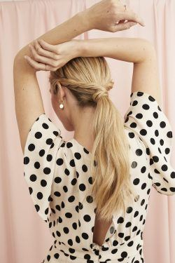 Blonde woman with a long twisted ponytail