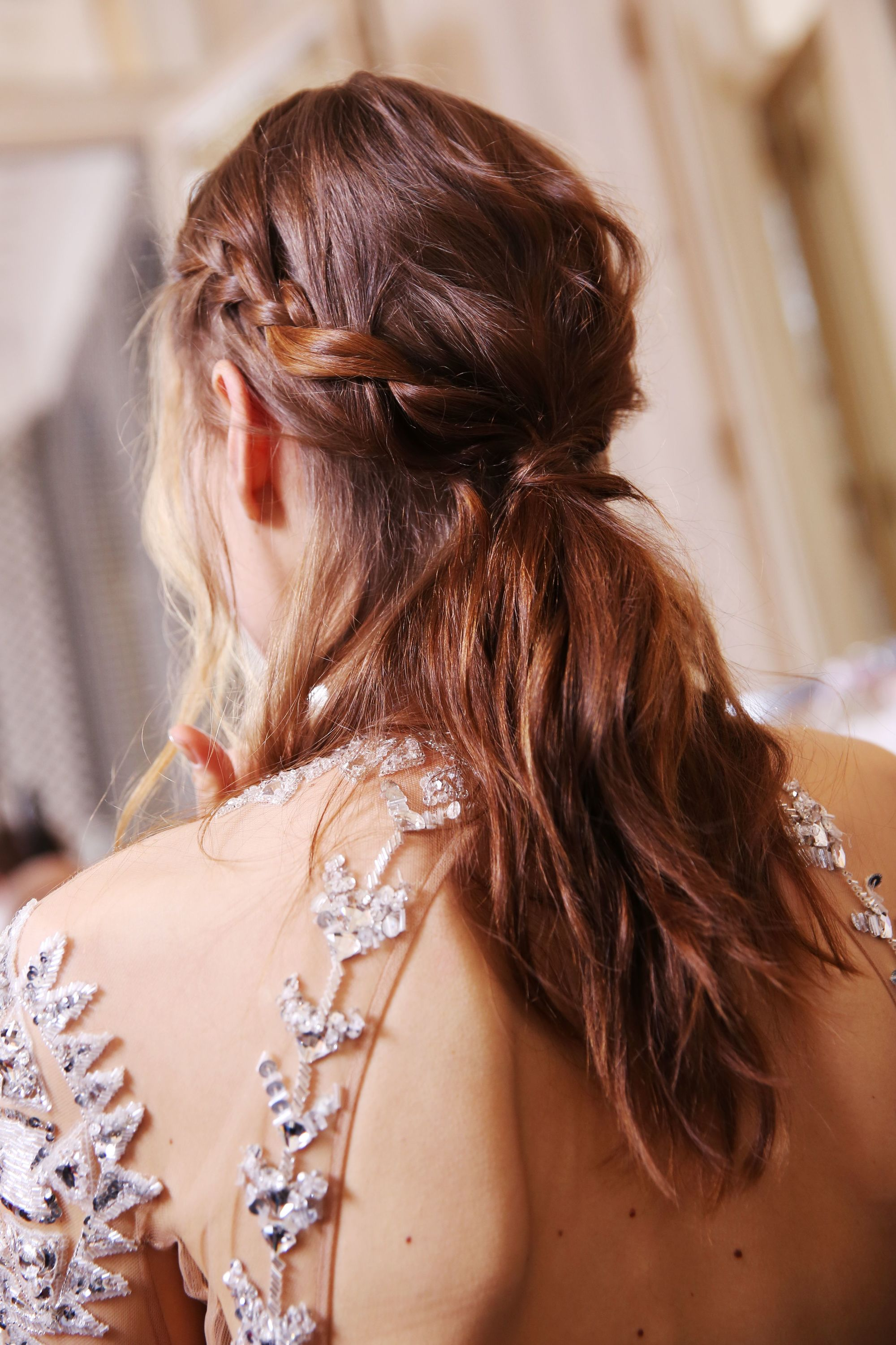 Brown hair in braided ponytail