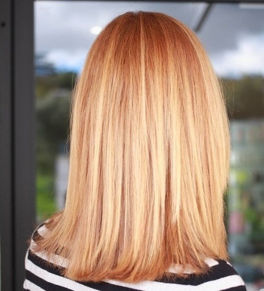 Woman with straight shoulder length red blonde hair
