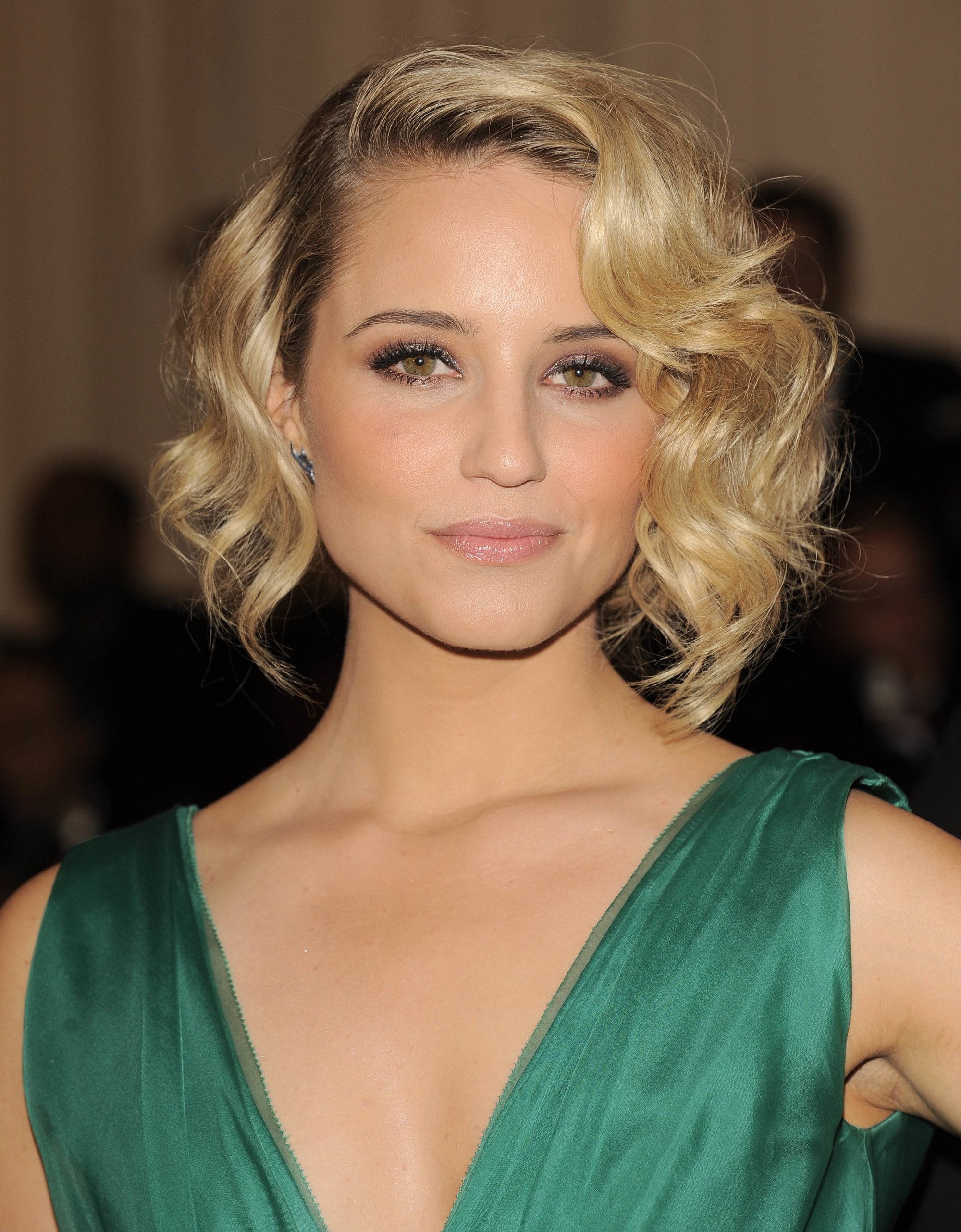 Dianna Agron with a short blonde retro curly bob