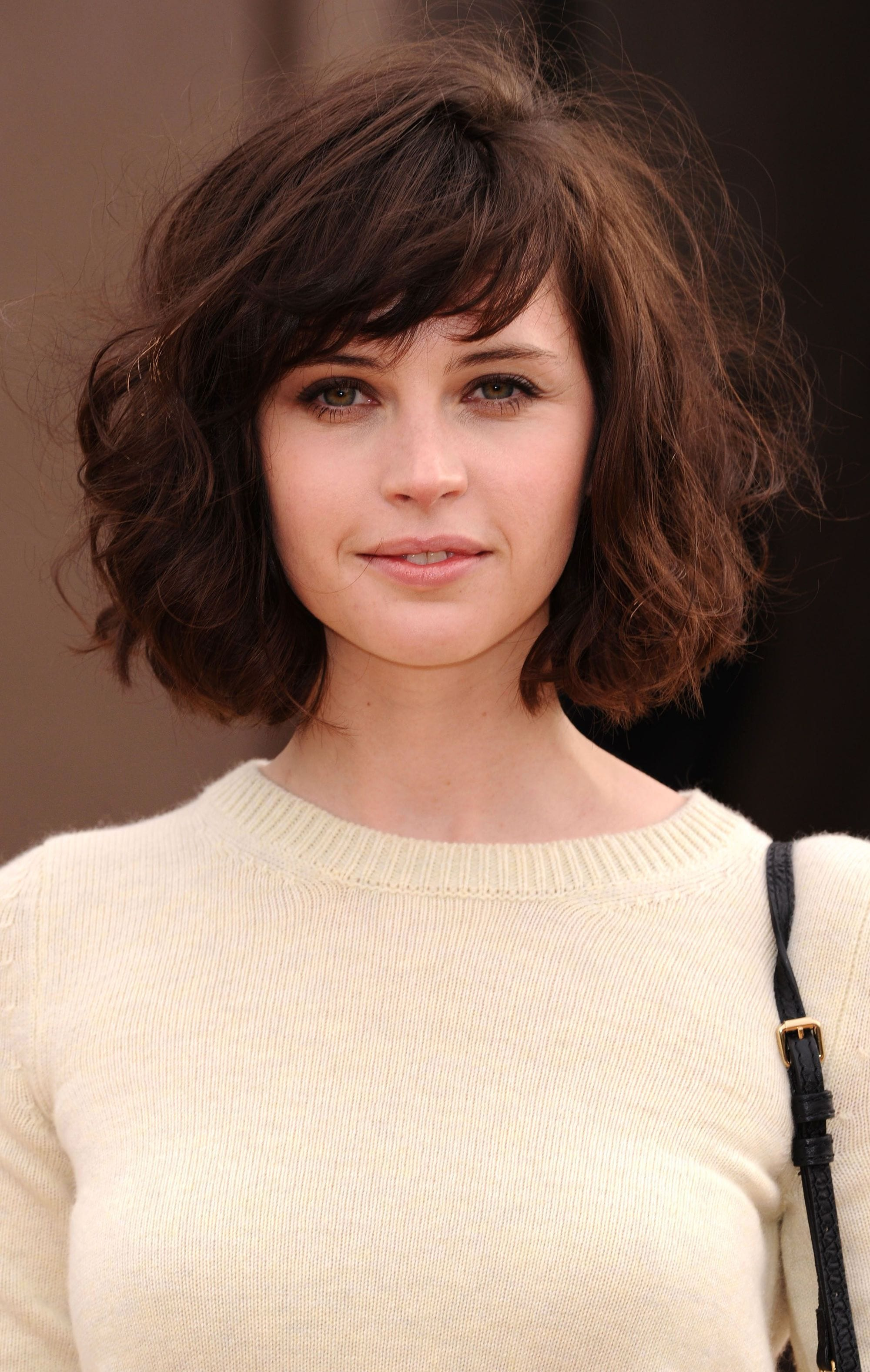 Felicity Jones with a shaggy layered bob with a fringe