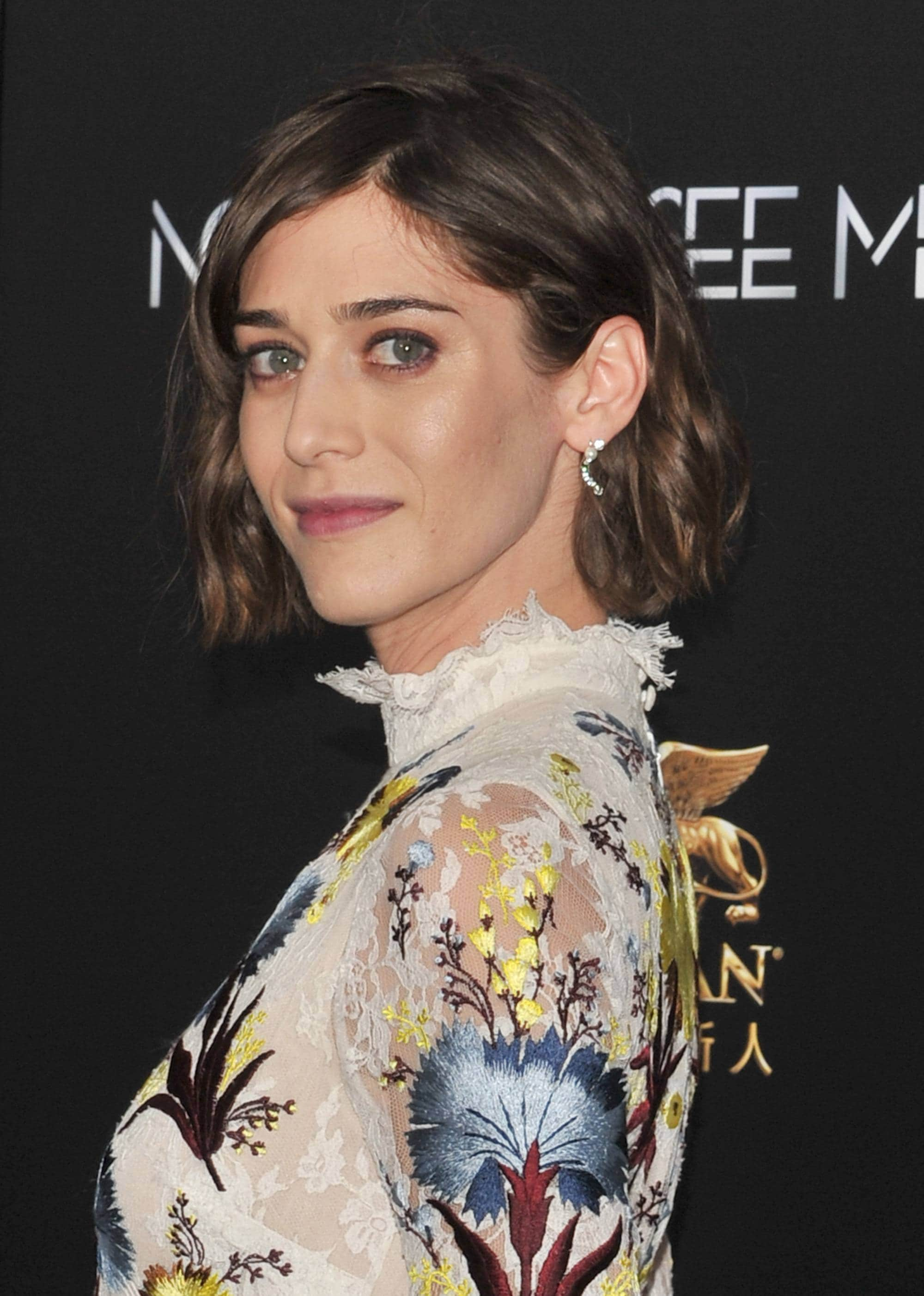 Lizzy Caplan with a brunette wavy bob