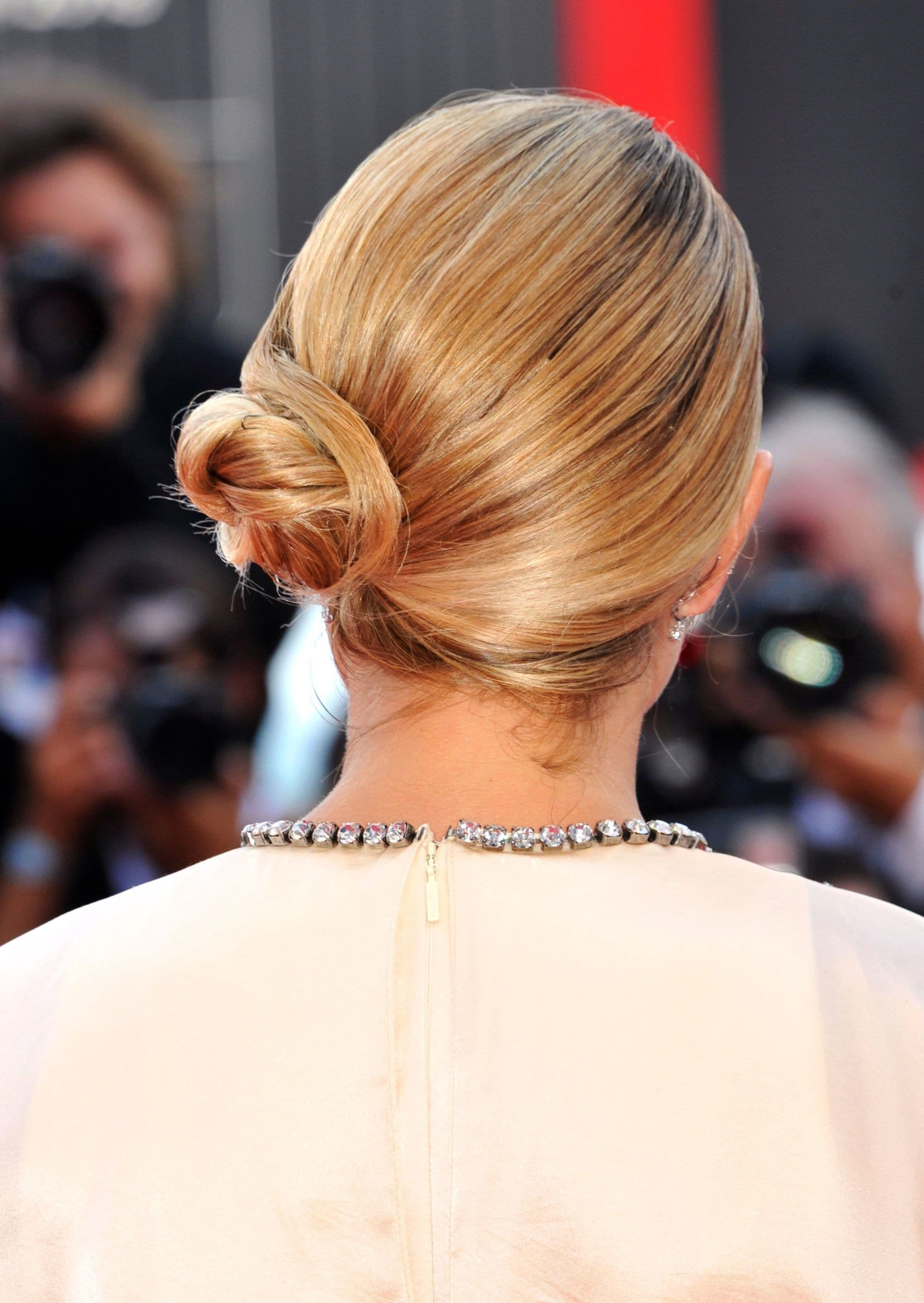 Woman with golden blonde sleek side bun