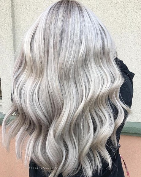 Woman with waist-length silver blonde waves