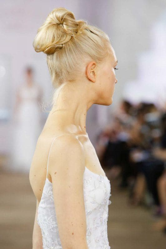 Undone sock bun on blone hair