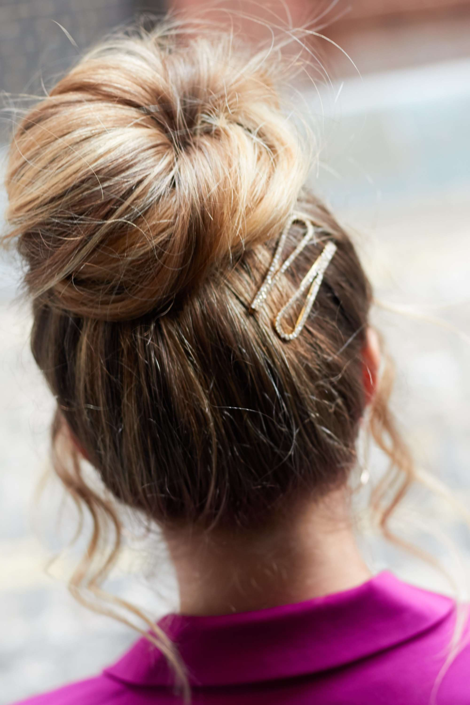 Blonde woman with sock bun updio with clip
