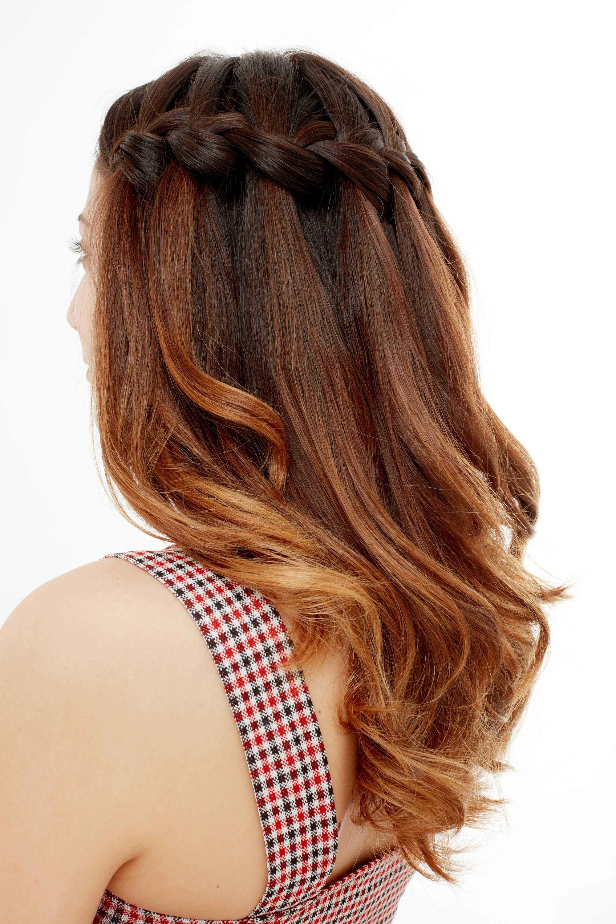 Woman with red brown ombre hair in a waterfall braid