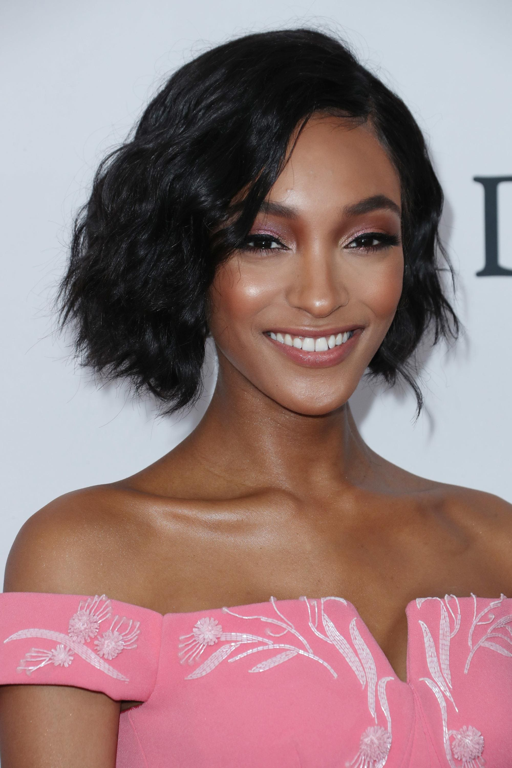 Jourdan Dunn with a black wavy bob with side parting
