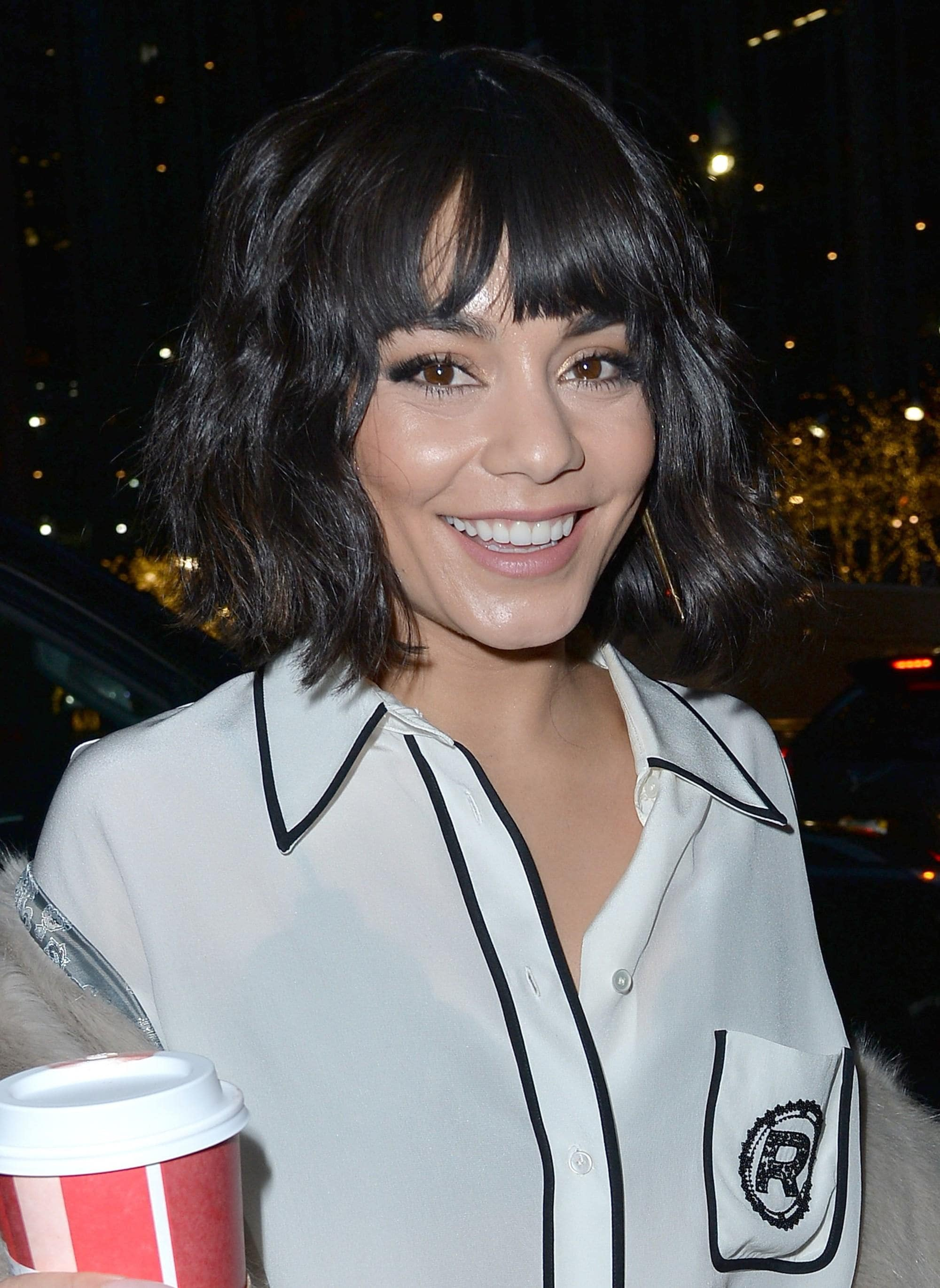 Vanessa Hudgens with a black wavy French bob with a fringe
