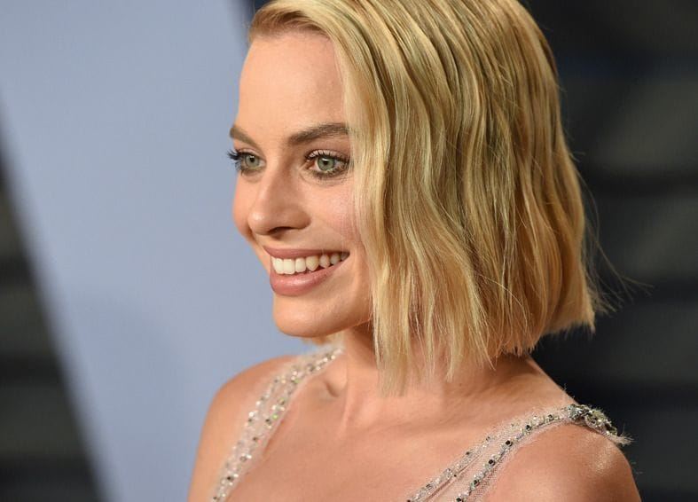 Margot Robbie with a blonde wavy graduated bob