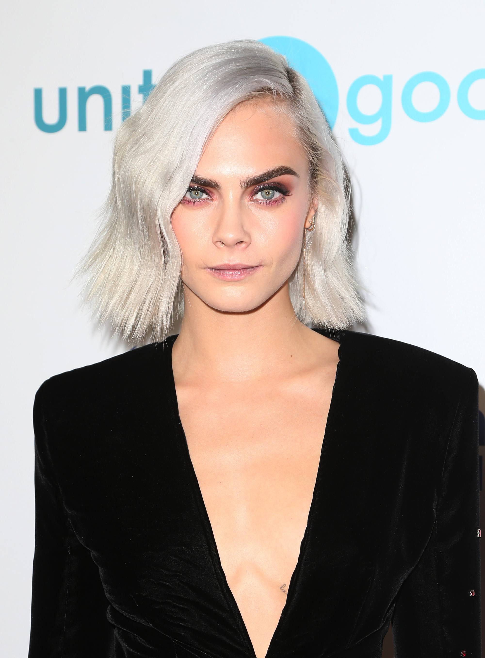 Cara Delevingne with a wavy grey bob