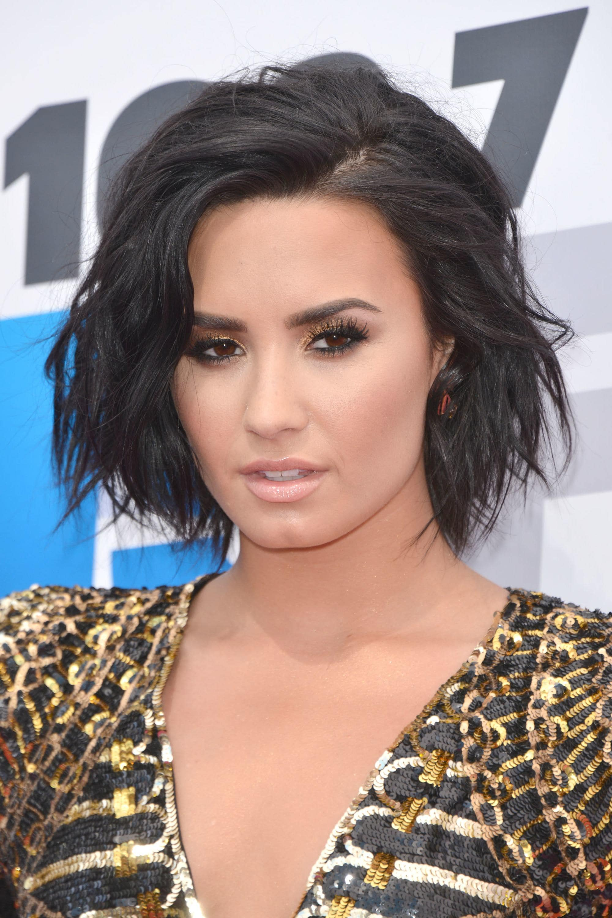 Demi Lovato with a wavy layered bob