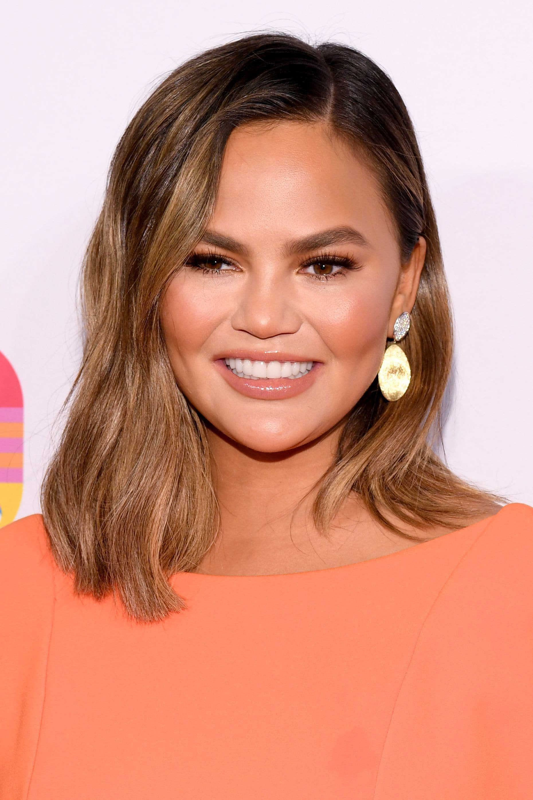 Chrissy Teigen with a brunette ombre wavy bob