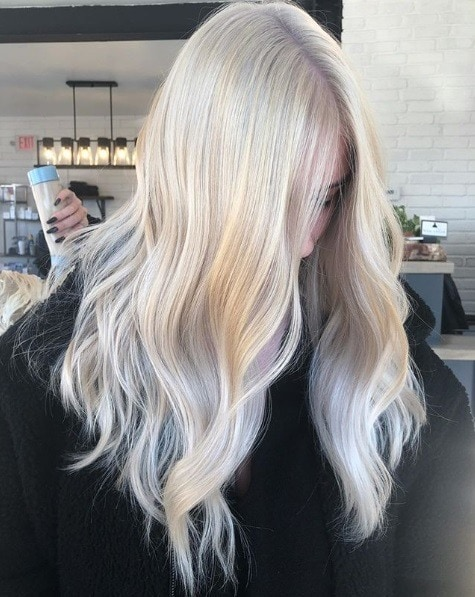 Woman with long wavy white blonde hair