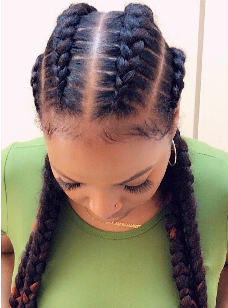 Woman with 4 cornrow braids