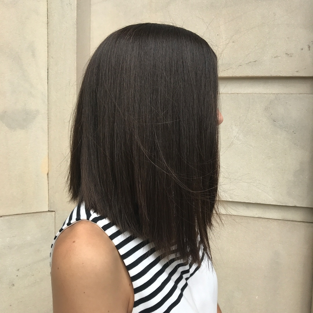 woman with angled dark straight lob