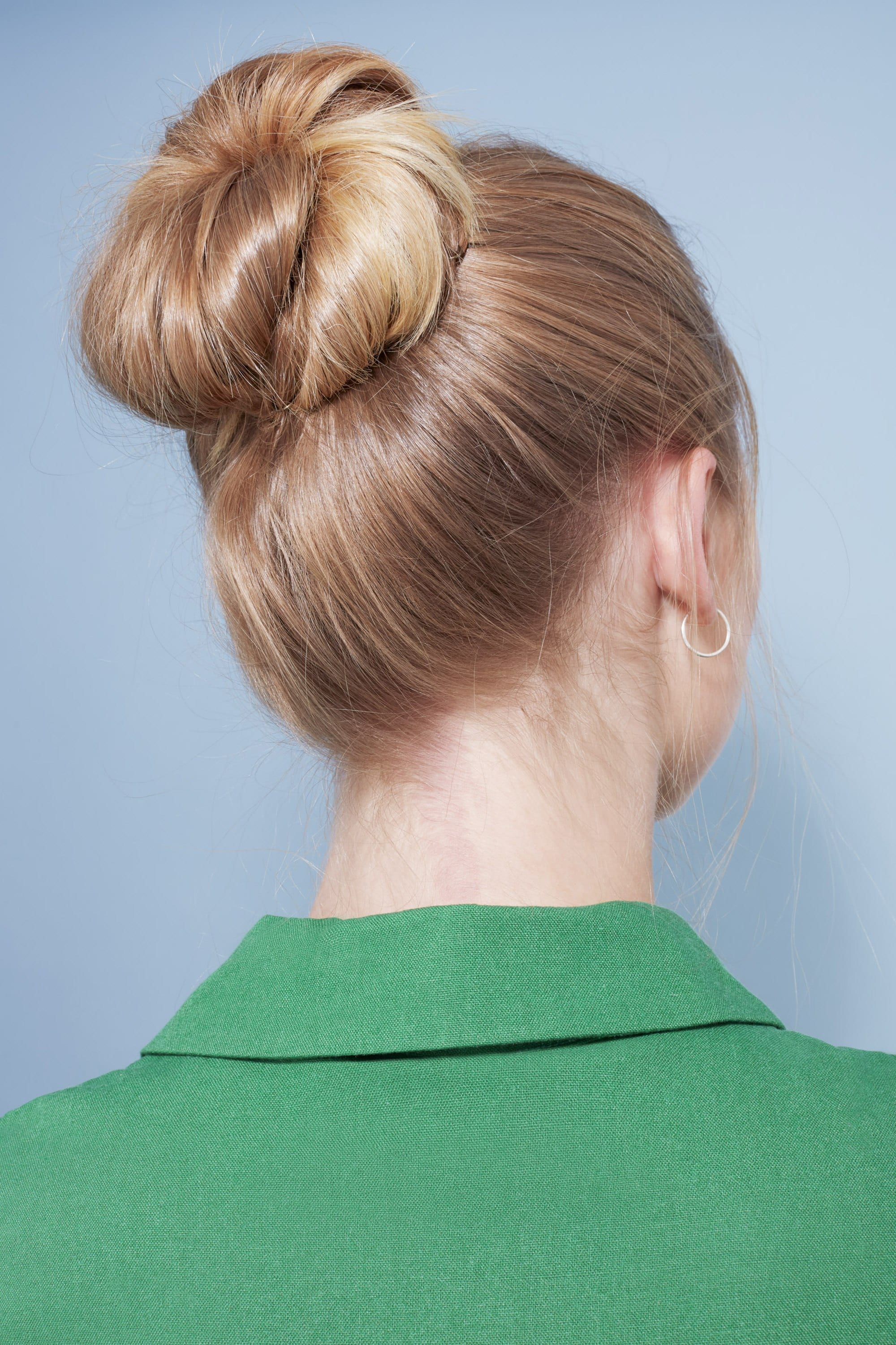 Woman with golden hair styled into a bun