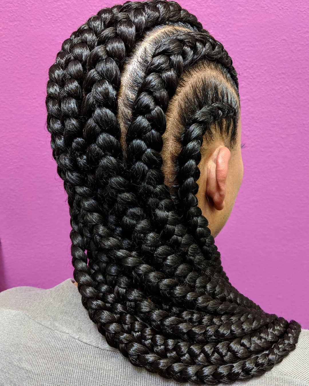 Woman with very big and long dark straight back cornrows