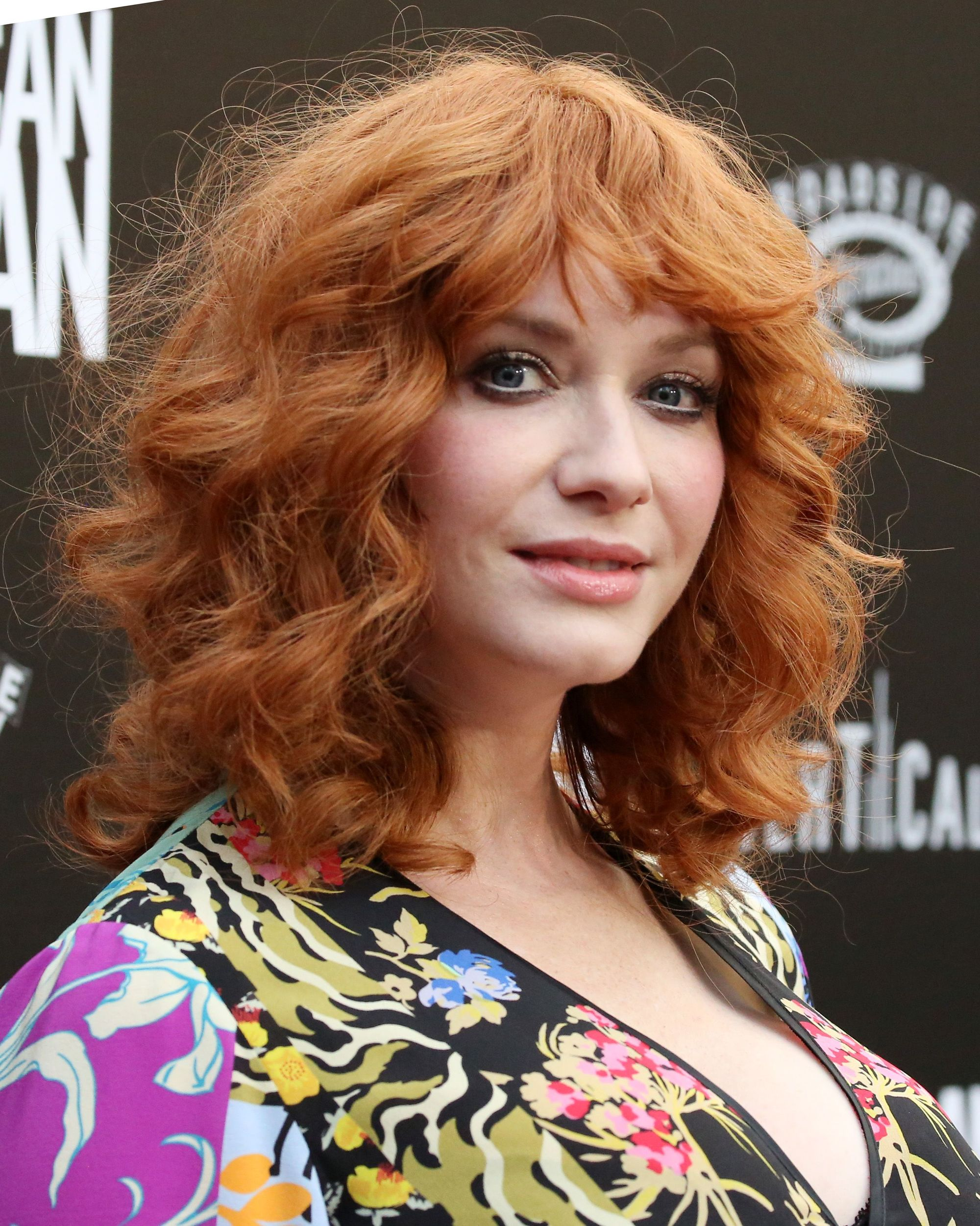 Christina Hendricks with ginger curly long bb with bangs