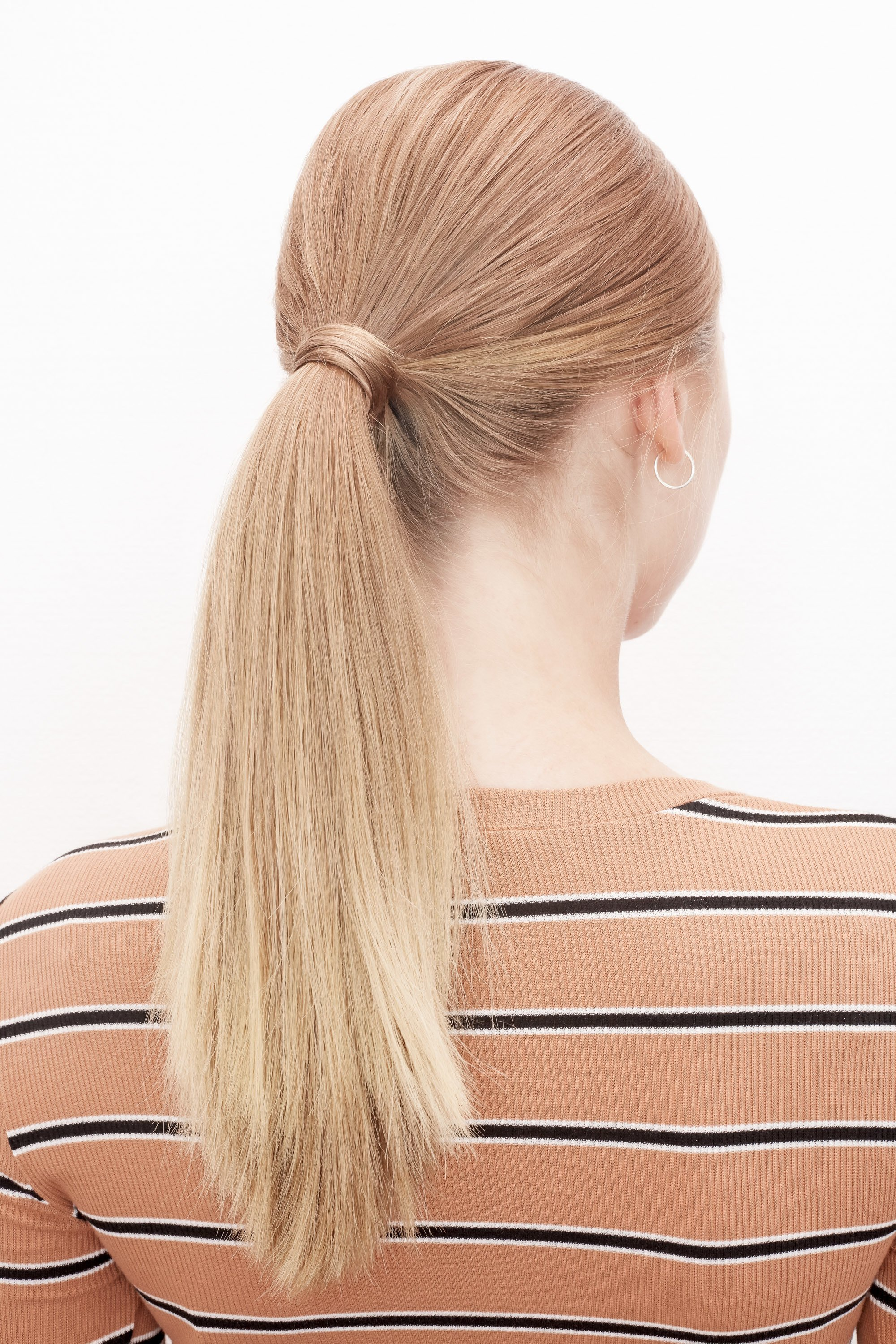 Woman with classic low ponytail hairstyle