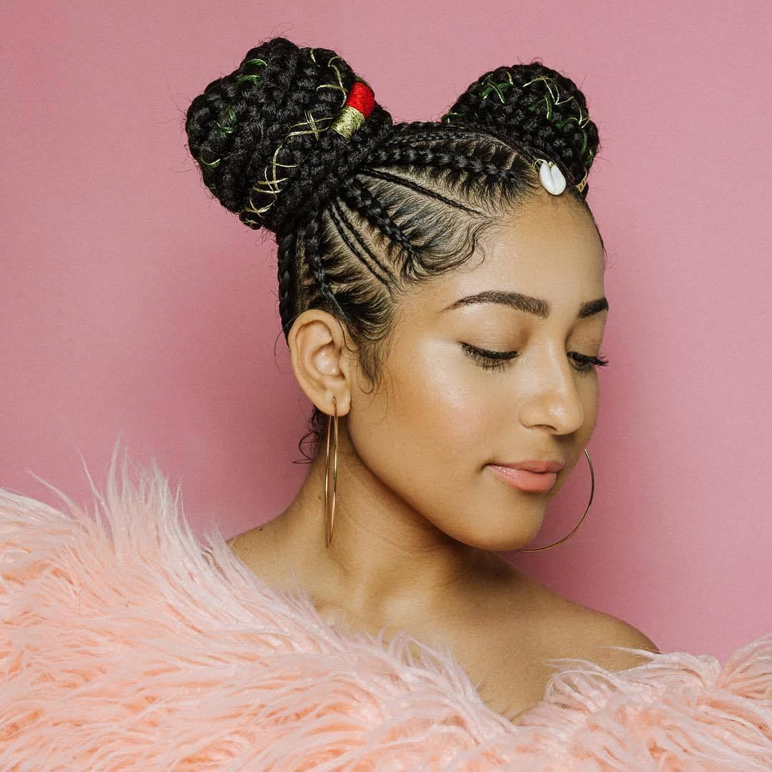 Woman with double cornrow braided buns