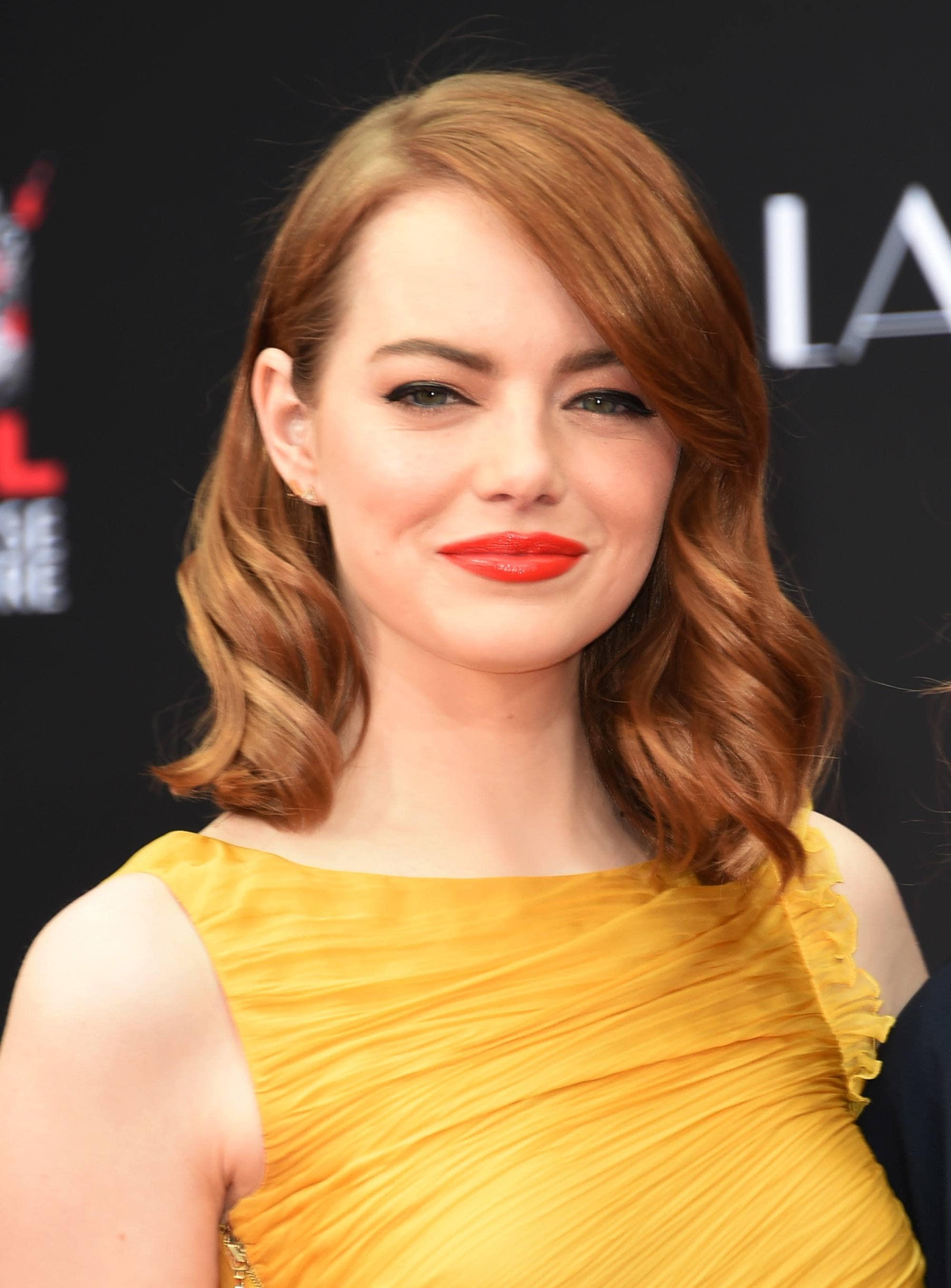 Emma Stone with auburn red long bob with side bangs