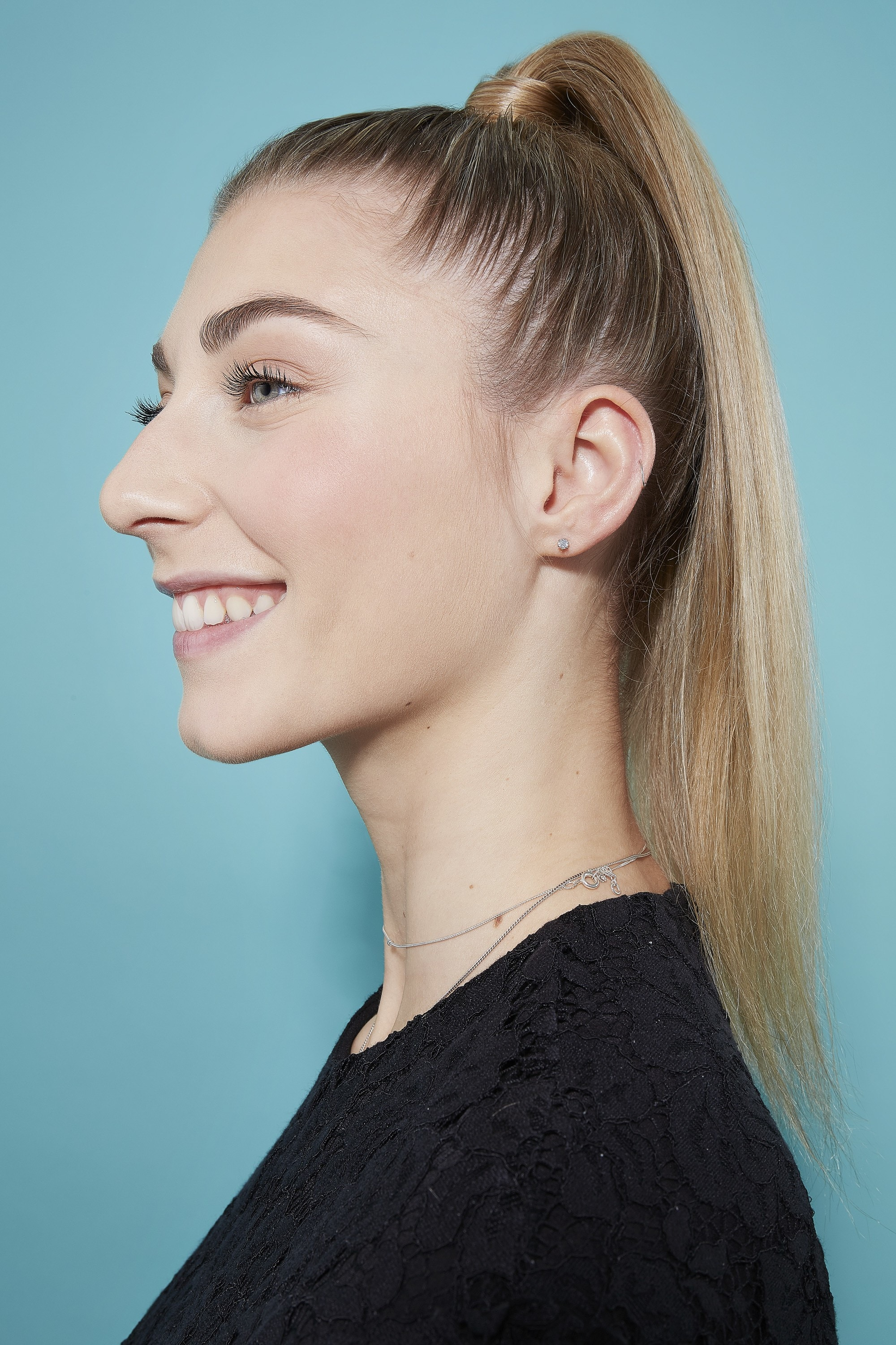 Woman with blonde high ponytail