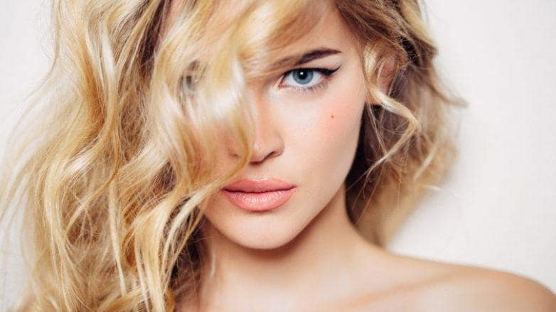 blonde woman with side swept wavy 2b hair