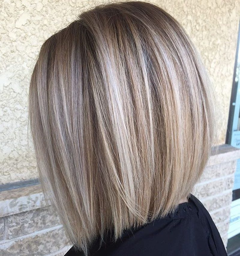 Woman with straight ash blonde layered lob