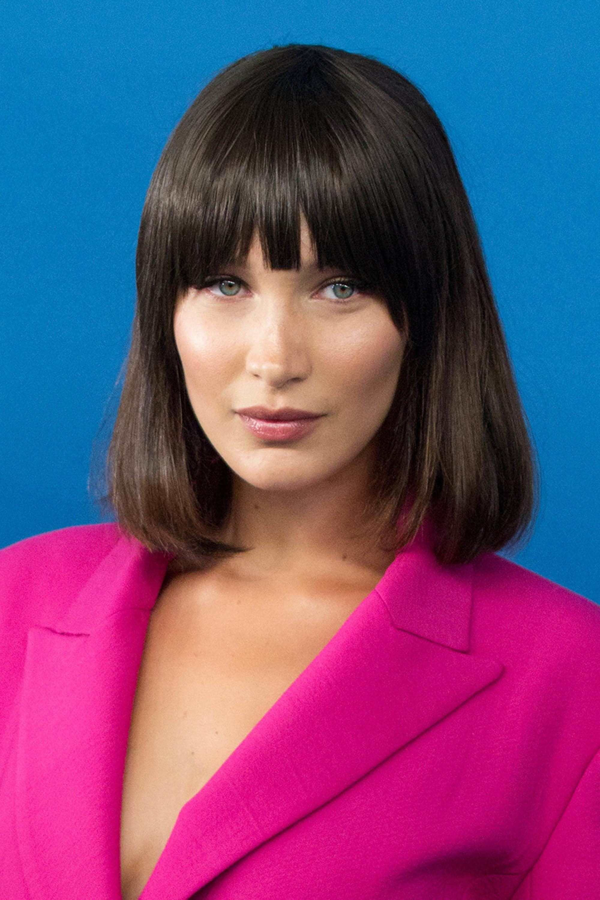 Bella Hadid with a brown lob and full bangs