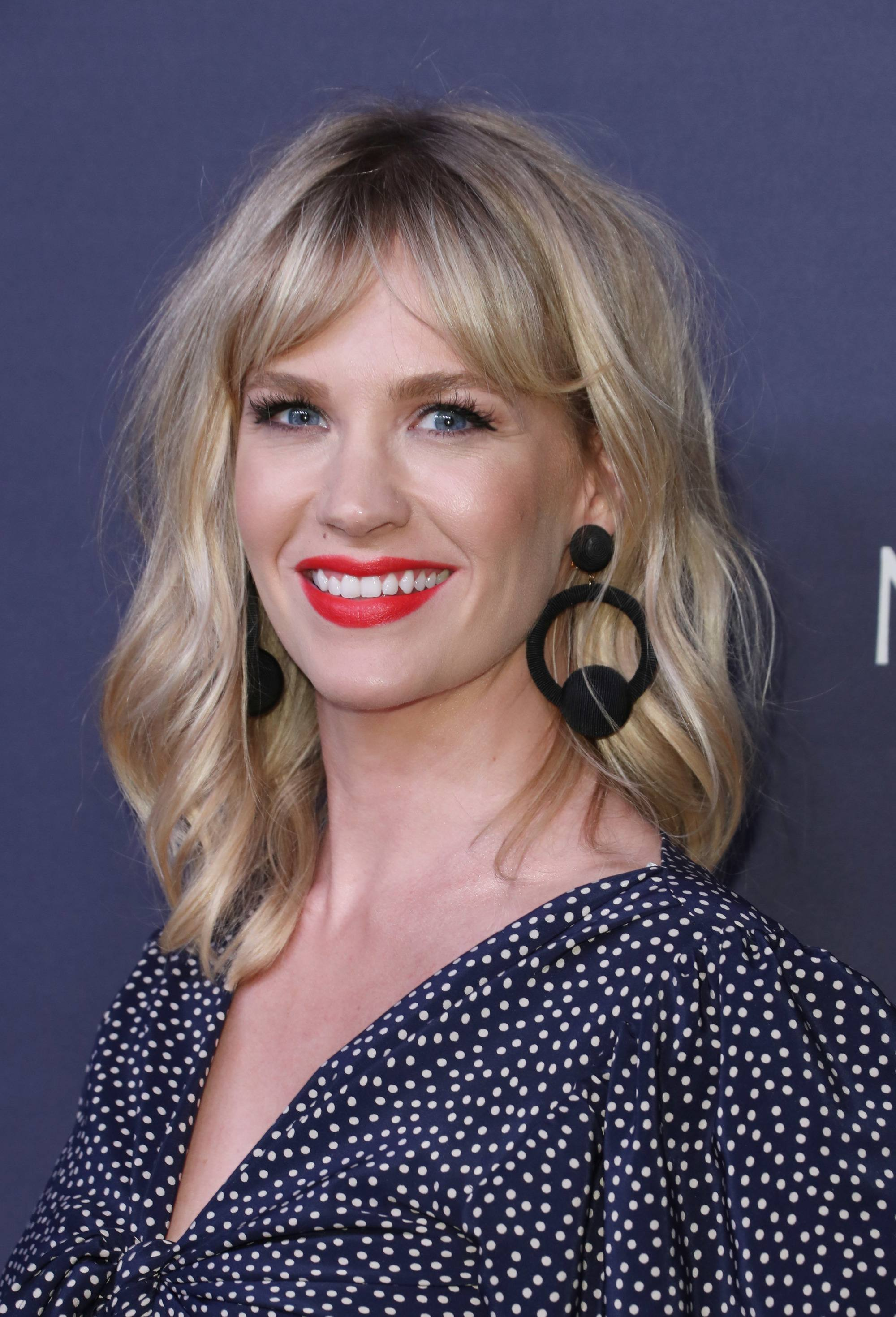 January Jones with a blonde wavy lob and bardot bangs