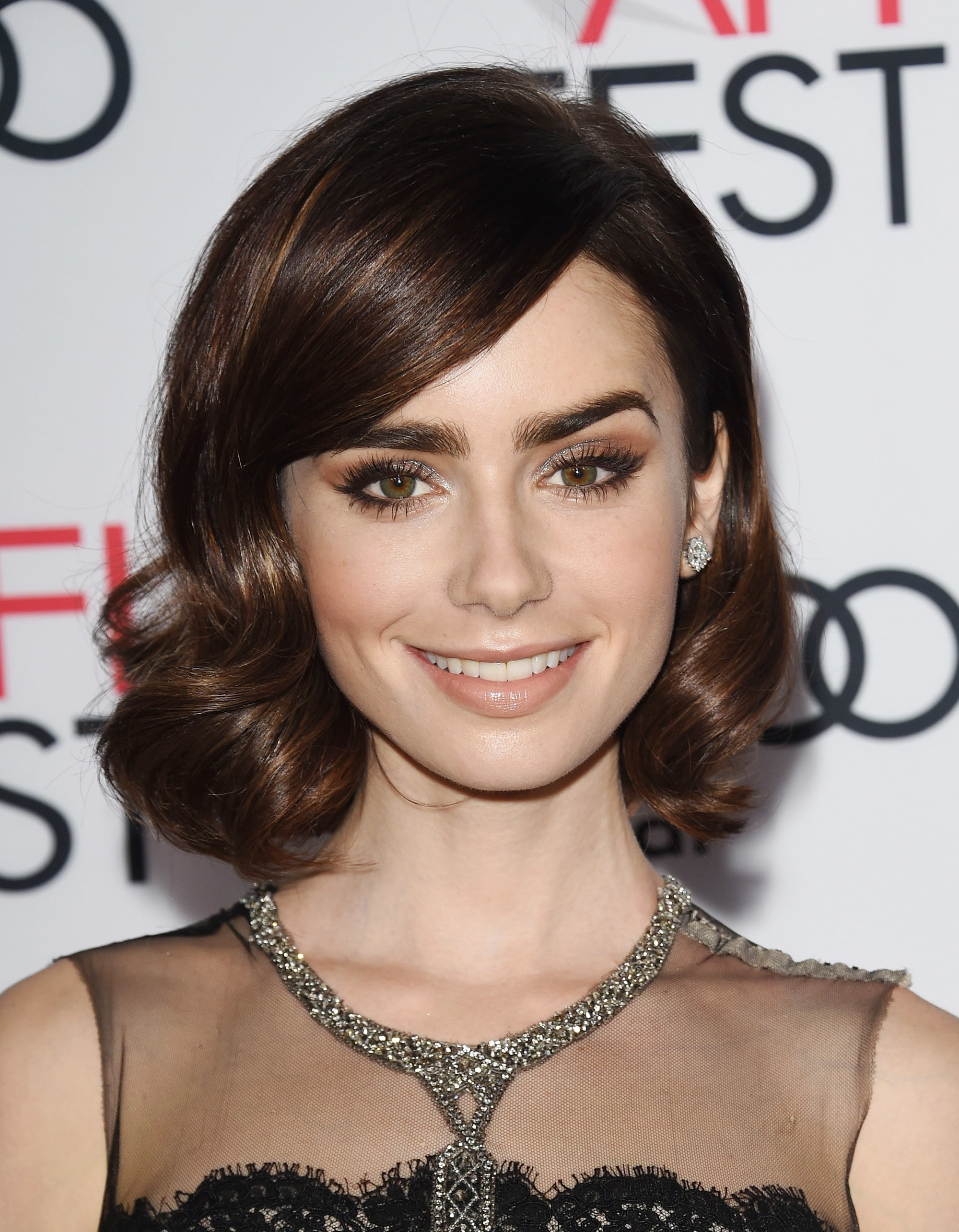 Lily Collins with brown curly lob with side fringe
