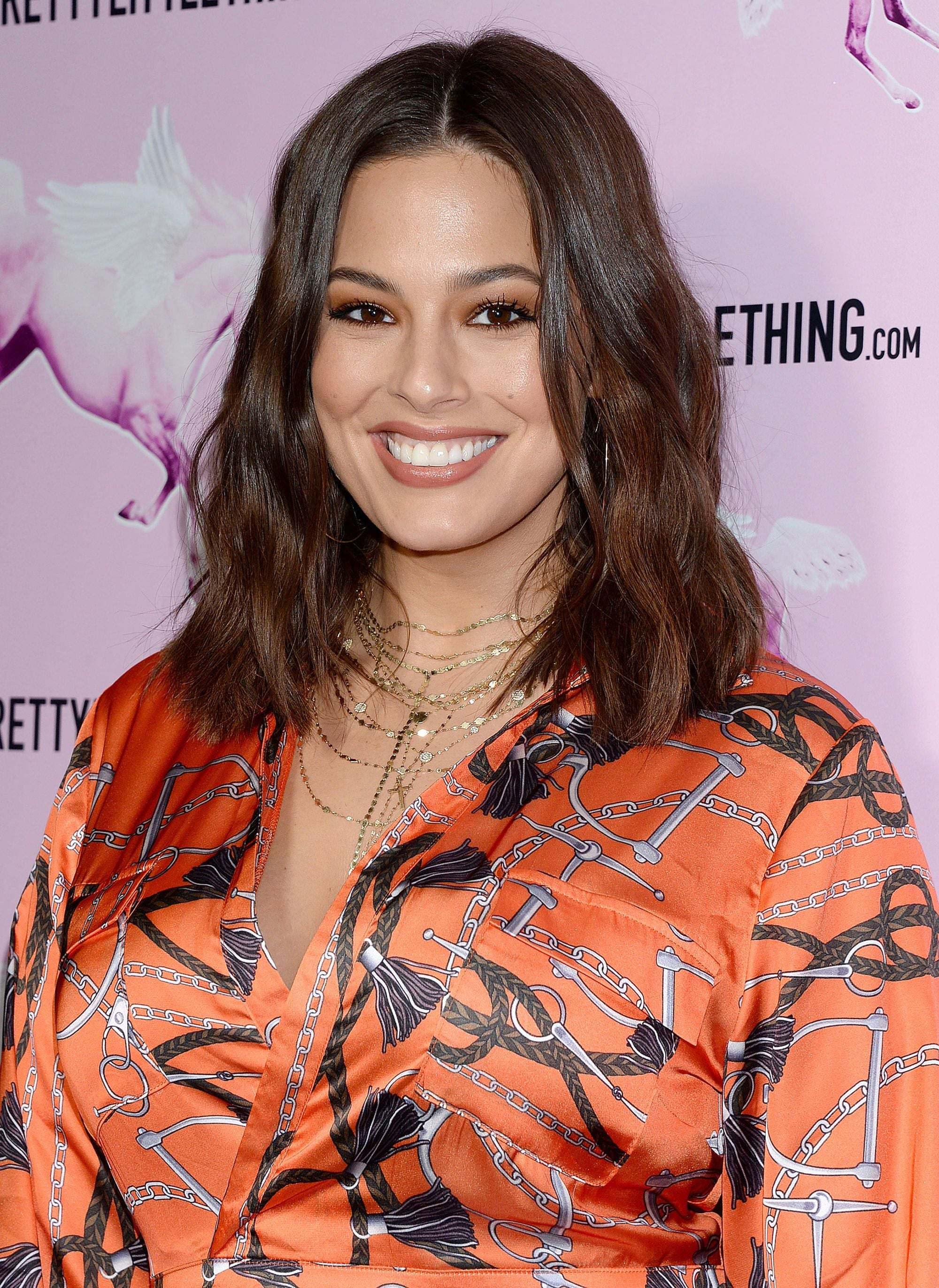 Ashley Graham with a brown balayage wavy lob