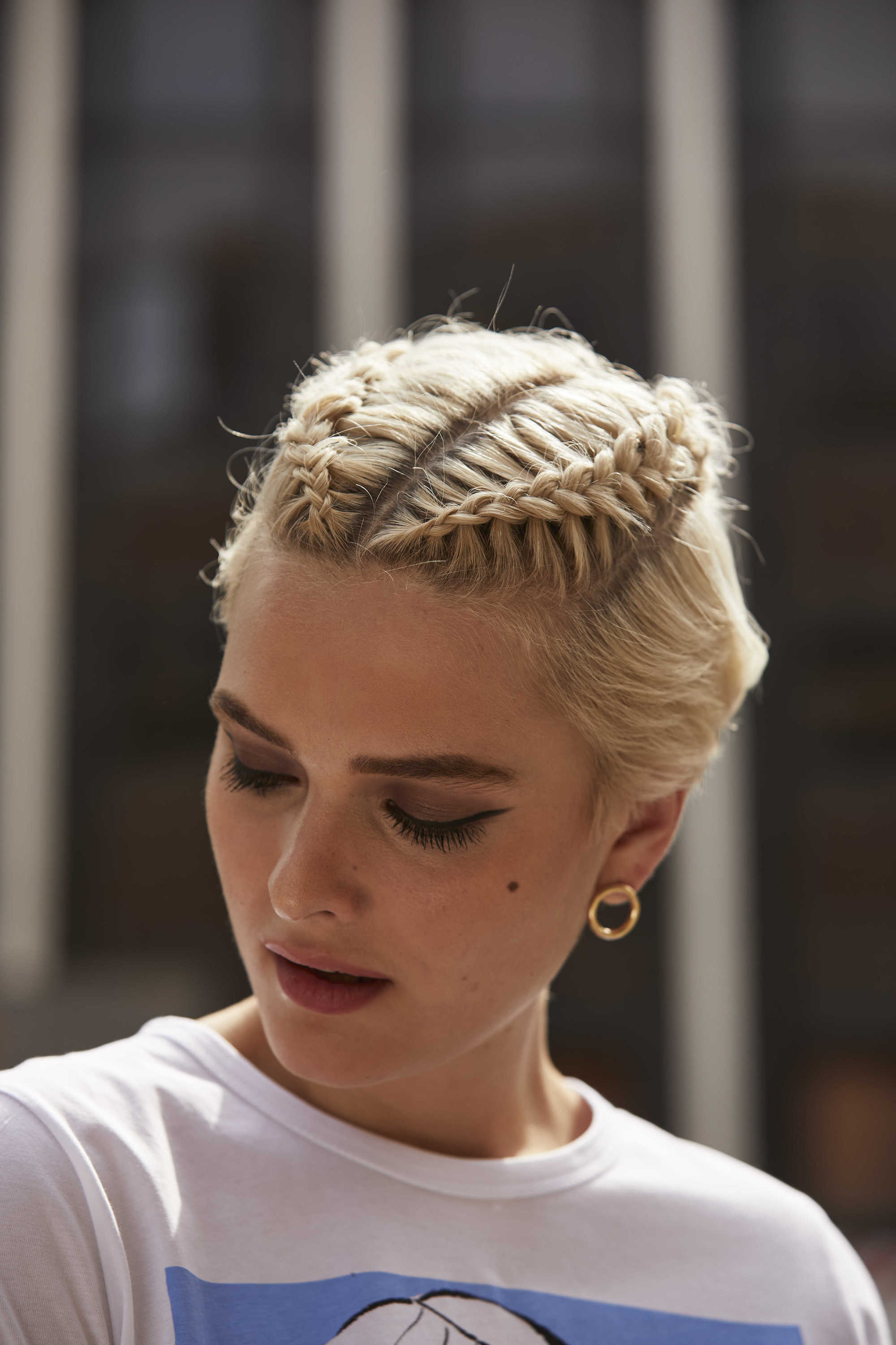 Woman with short blonde hair with mini braids